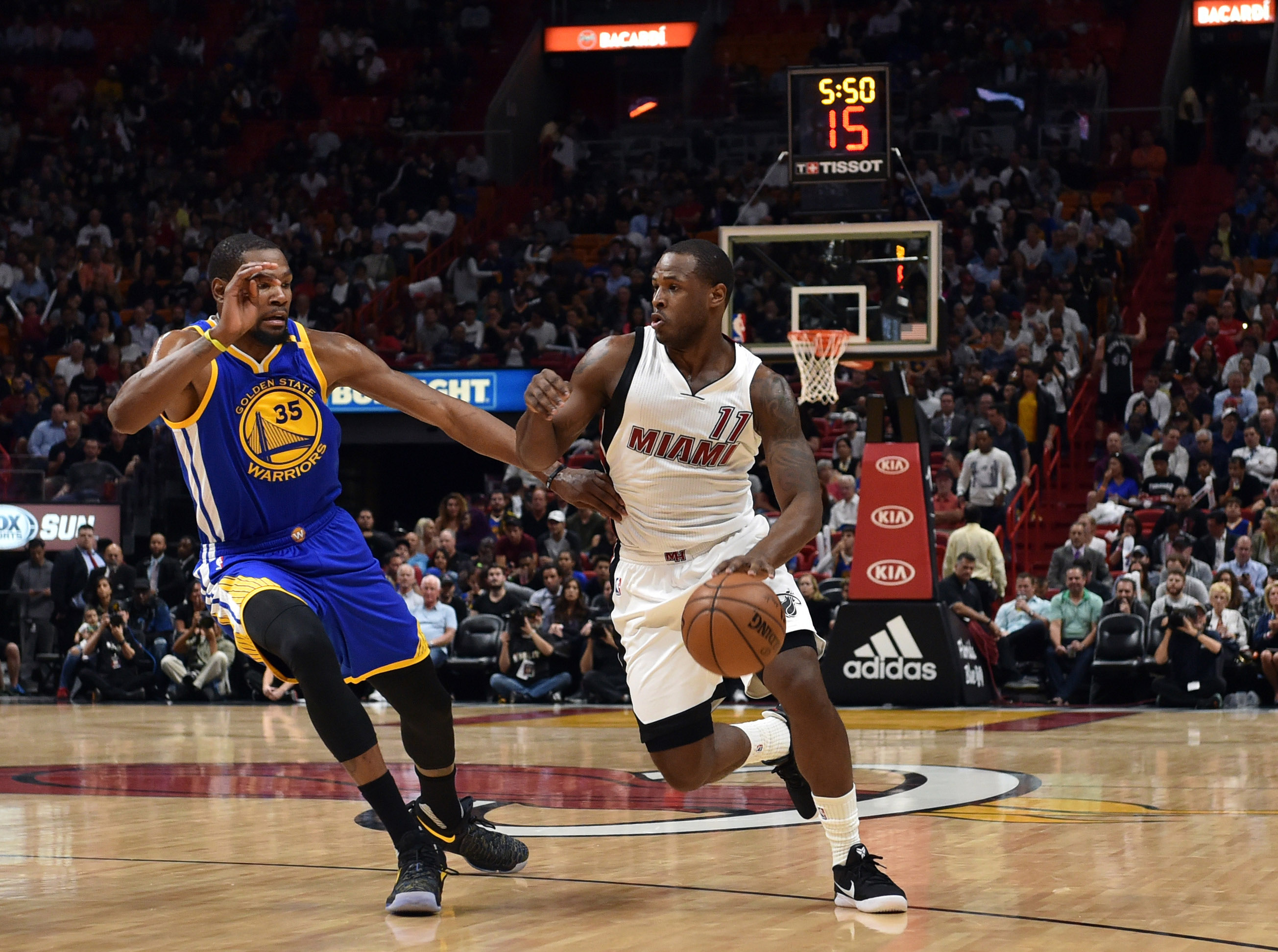 Jan 23, 2017; Miami, FL, USA; Miami Heat guard Dion Waiters (11) drives to the basket as Golden State Warriors forward Kevin Durant (35) defends during the first half at American Airlines Arena. Mandatory Credit: Steve Mitchell-USA TODAY Sports