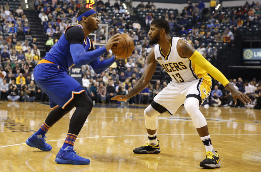 Jan 23, 2017; Indianapolis, IN, USA; New York Knicks forward Carmelo Anthony (7) is guarded by Indiana Pacers forward Paul George (13) at Bankers Life Fieldhouse. Mandatory Credit: Brian Spurlock-USA TODAY Sports