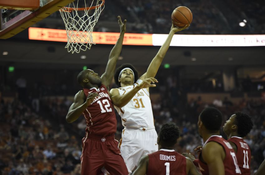 Jan 23, 2017; Austin, TX, USA; Texas Longhorns forward Jarrett Allen (31) shoots against Oklahoma Sooners forwards Kadeem Lattin (12) during the first half at the Frank Erwin Center. Mandatory Credit: Brendan Maloney-USA TODAY Sports
