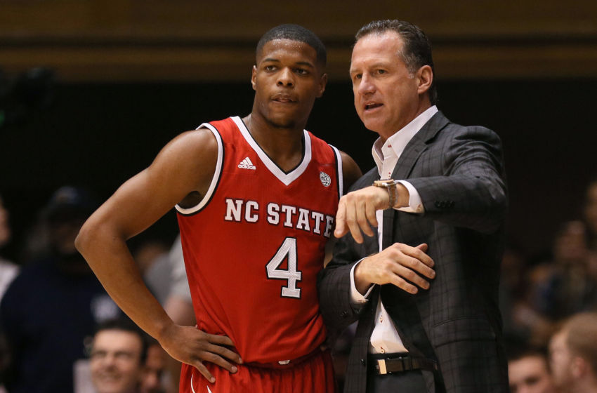 Jan 23, 2017; Durham, NC, USA; North Carolina State Wolfpack head coach Mark Gottfried talks with guard Dennis Smith Jr. (4) on the sidelines in the first half of their game against the Duke Blue Devils at Cameron Indoor Stadium. Mandatory Credit: Mark Dolejs-USA TODAY Sports
