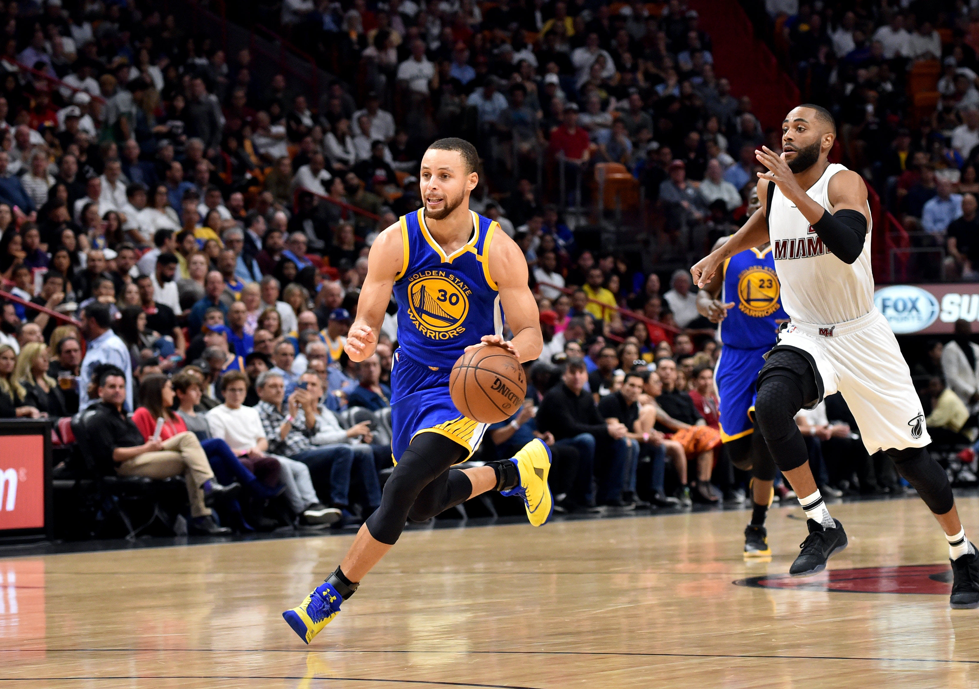 Jan 23, 2017; Miami, FL, USA; Golden State Warriors guard Stephen Curry (30) dribbles the ball up court as Miami Heat guard Wayne Ellington (2) gives chase during the second half at American Airlines Arena. The Heat defeated the Golden State Warriors 105-102. Mandatory Credit: Steve Mitchell-USA TODAY Sports