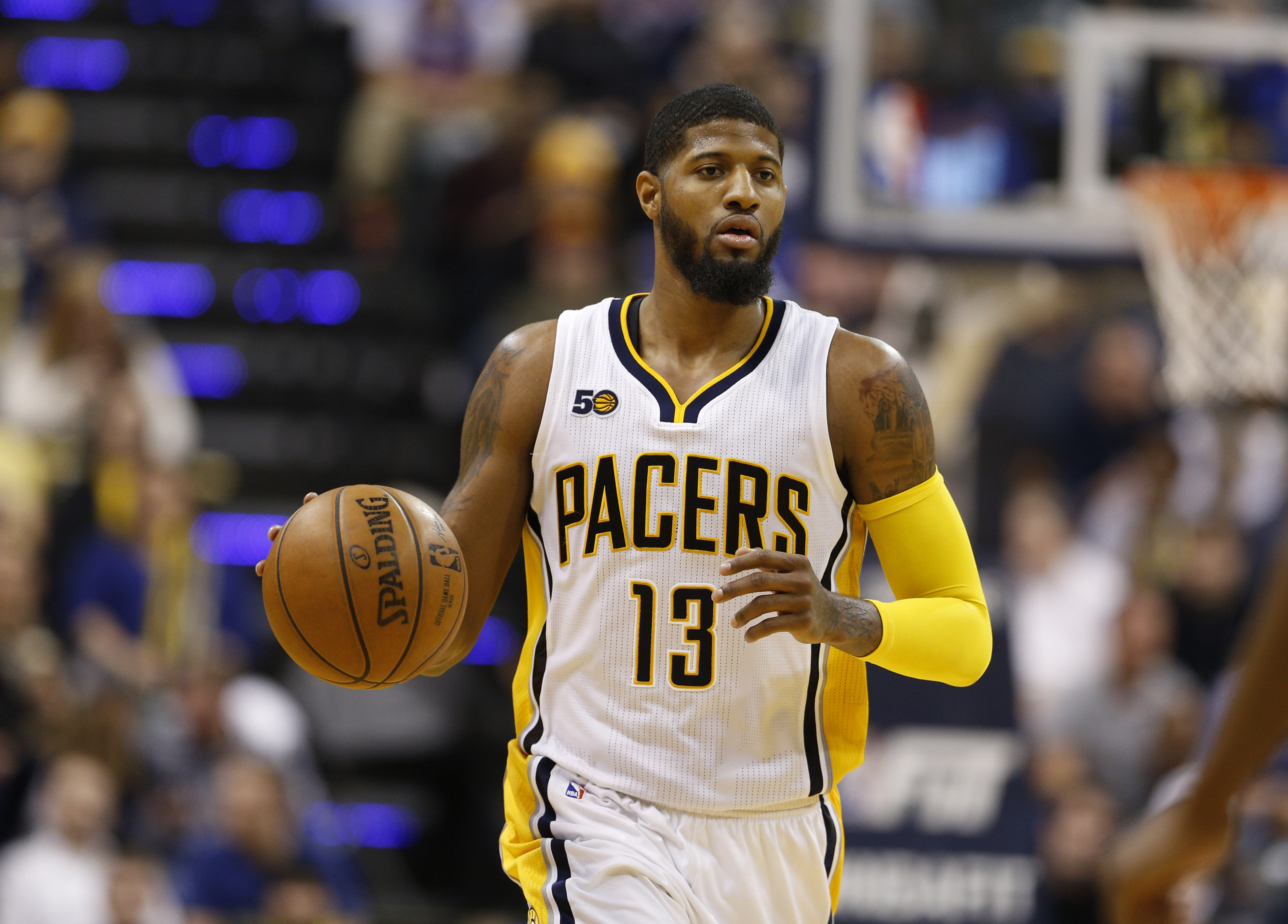 Jan 23, 2017; Indianapolis, IN, USA; Indiana Pacers forward Paul George (13) brings the ball up court against the New York Knicks at Bankers Life Fieldhouse. New York defeats Indiana 109-103. Mandatory Credit: Brian Spurlock-USA TODAY Sports