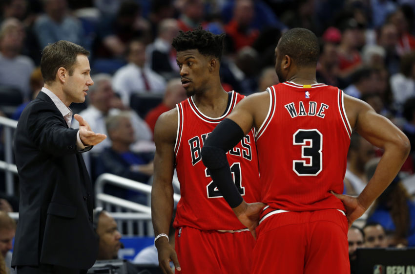 Jan 24, 2017; Orlando, FL, USA; Chicago Bulls head coach Fred Hoiberg talks with Chicago Bulls forward Jimmy Butler (21) and guard Dwyane Wade (3) during the second quarter at Amway Center. Mandatory Credit: Kim Klement-USA TODAY Sports