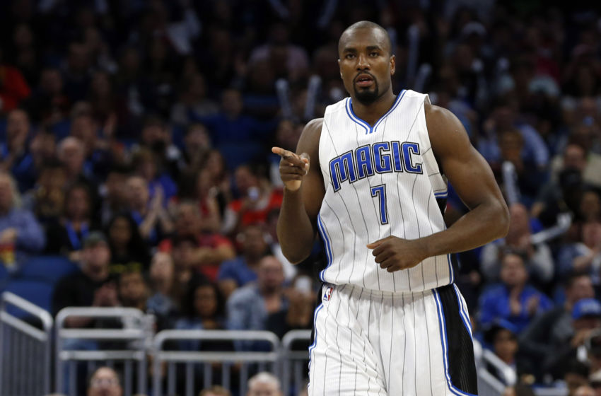 Jan 24, 2017; Orlando, FL, USA; Orlando Magic forward Serge Ibaka (7) points after he makes a three pointer during the second quarter at Amway Center. Mandatory Credit: Kim Klement-USA TODAY Sports