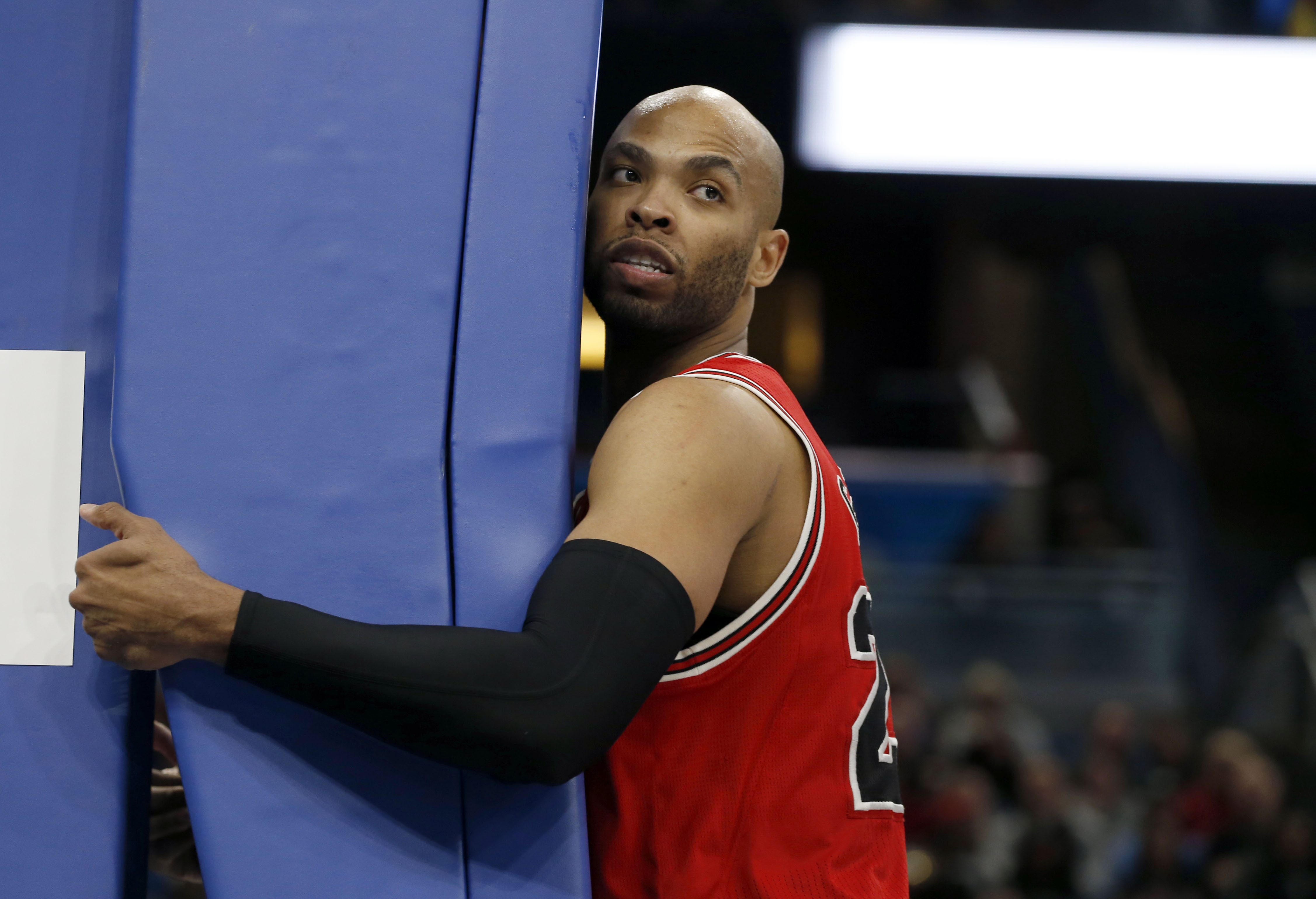 Jan 24, 2017; Orlando, FL, USA; Chicago Bulls forward Taj Gibson (22) holds onto the basket post after being fouled during the second half at Amway Center. The Bulls won 100-92. Mandatory Credit: Kim Klement-USA TODAY Sports