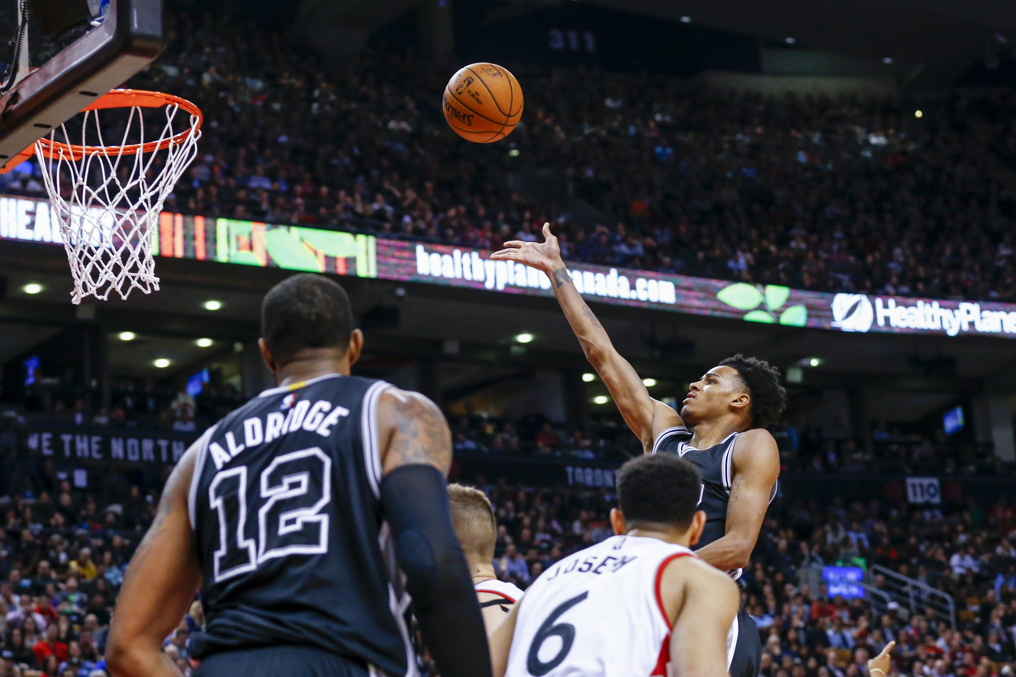 Jan 24, 2017; Toronto, Ontario, CAN; San Antonio Spurs guard Dejounte Murray (5) shoots the ball against the Toronto Raptors in the second half at Air Canada Centre. Spurs defeat the Raptors 108-106. Mandatory Credit: Kevin Sousa-USA TODAY Sports