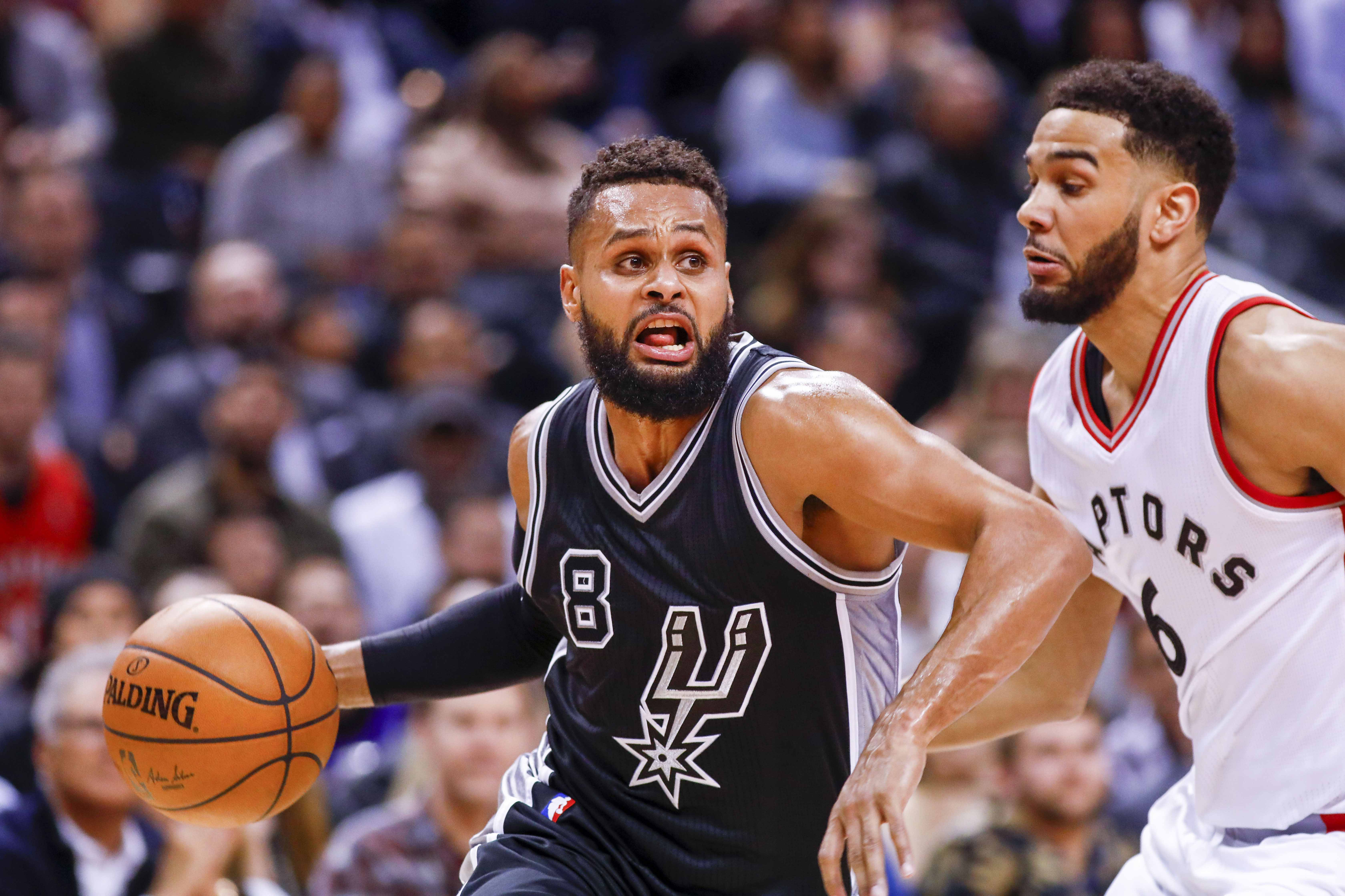 Jan 24, 2017; Toronto, Ontario, CAN; San Antonio Spurs guard Patty Mills (8) dribbles the all around Toronto Raptors guard Cory Joseph (6) in the second half at Air Canada Centre. Spurs defeat the Raptors 108-106. Mandatory Credit: Kevin Sousa-USA TODAY Sports