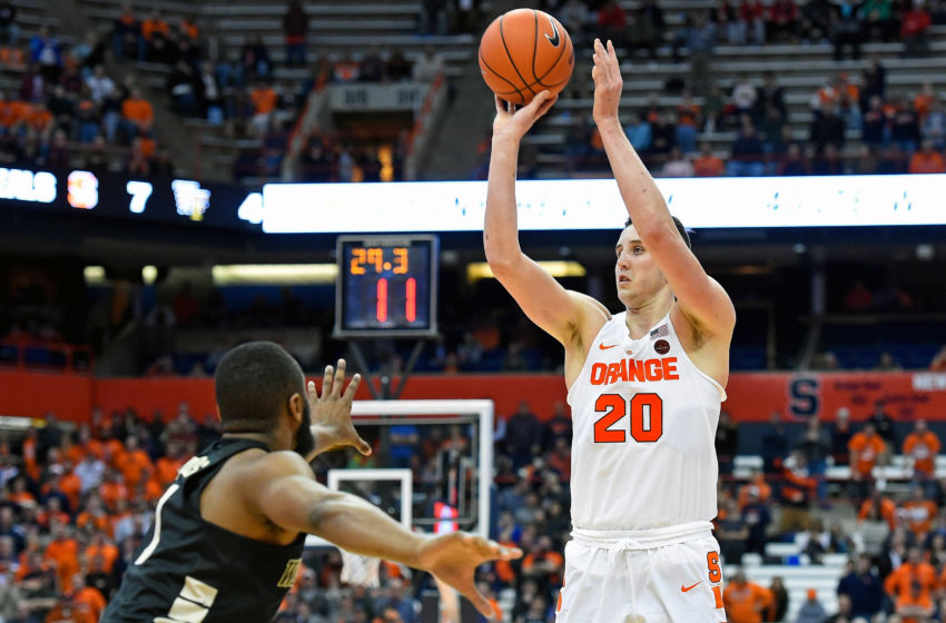 Jan 24, 2017; Syracuse, NY, USA; Syracuse Orange forward Tyler Lydon (20) shoots the ball over Wake Forest Demon Deacons guard Keyshawn Woods (1) during the second half at the Carrier Dome. The Orange won 81-76. Mandatory Credit: Rich Barnes-USA TODAY Sports