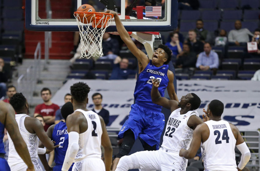 Jan 25, 2017; Washington, DC, USA; Creighton Bluejays center Justin Patton (23) dunks the ball as Georgetown Hoyas forward Akoy Agau (22) looks on in the second half at Verizon Center. The Hoyas won 71-51. Mandatory Credit: Geoff Burke-USA TODAY Sports