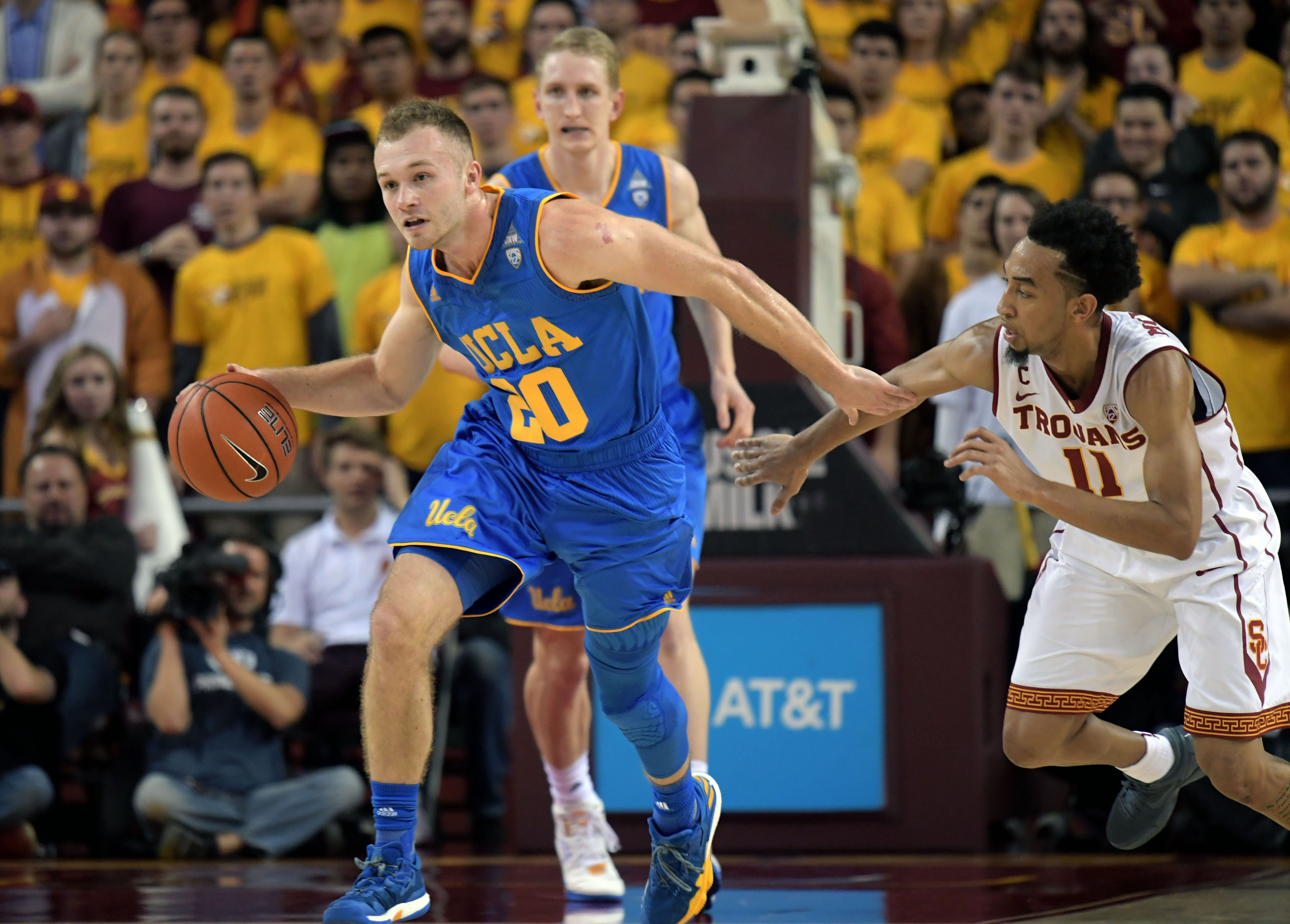 Jan 25, 2017; Los Angeles, CA, USA; UCLA Bruins guard Bryce Alford (20) controls the ball against Southern California Trojans guard Jordan McLaughlin (11) during the first half at Galen Center. Mandatory Credit: Kirby Lee-USA TODAY Sports