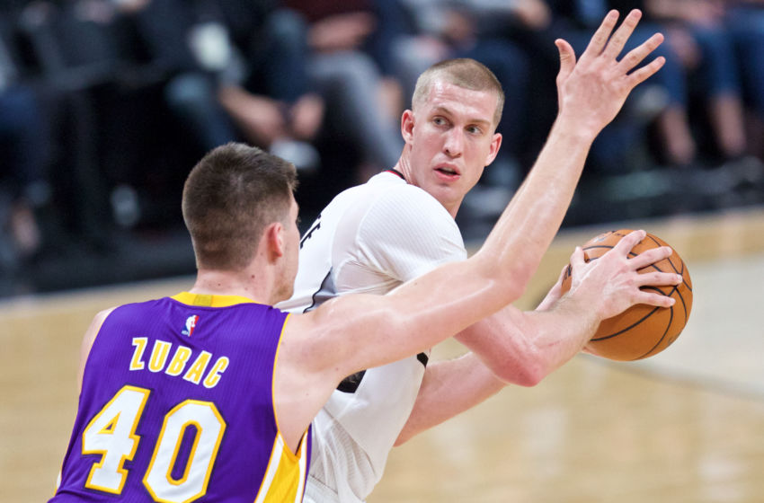 Jan 25, 2017; Portland, OR, USA; Portland Trail Blazers center Mason Plumlee (24) looks for a pass around Los Angeles Lakers center Ivica Zubac (40) during the third quarter at the Moda Center. Mandatory Credit: Craig Mitchelldyer-USA TODAY Sports