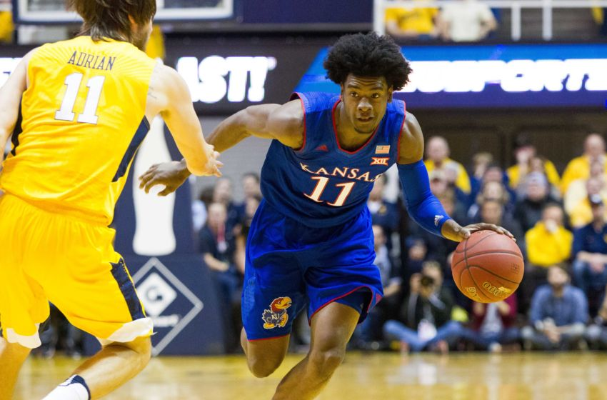 Jan 24, 2017; Morgantown, WV, USA; Kansas Jayhawks guard Josh Jackson (11) drives towards the basket during the first half against the West Virginia Mountaineers at WVU Coliseum. Mandatory Credit: Ben Queen-USA TODAY Sports