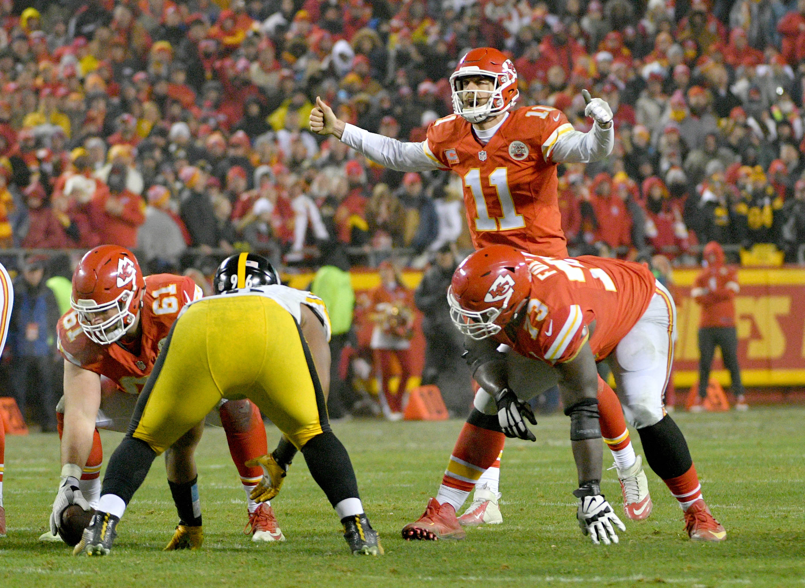 Jan 15, 2017; Kansas City, MO, USA; Kansas City Chiefs quarterback Alex Smith (11) signals on the line of scrimmage in the AFC Divisional playoff game against the Pittsburgh Steelers at Arrowhead Stadium. Pittsburgh won 18-16. Mandatory Credit: Denny Medley-USA TODAY Sports