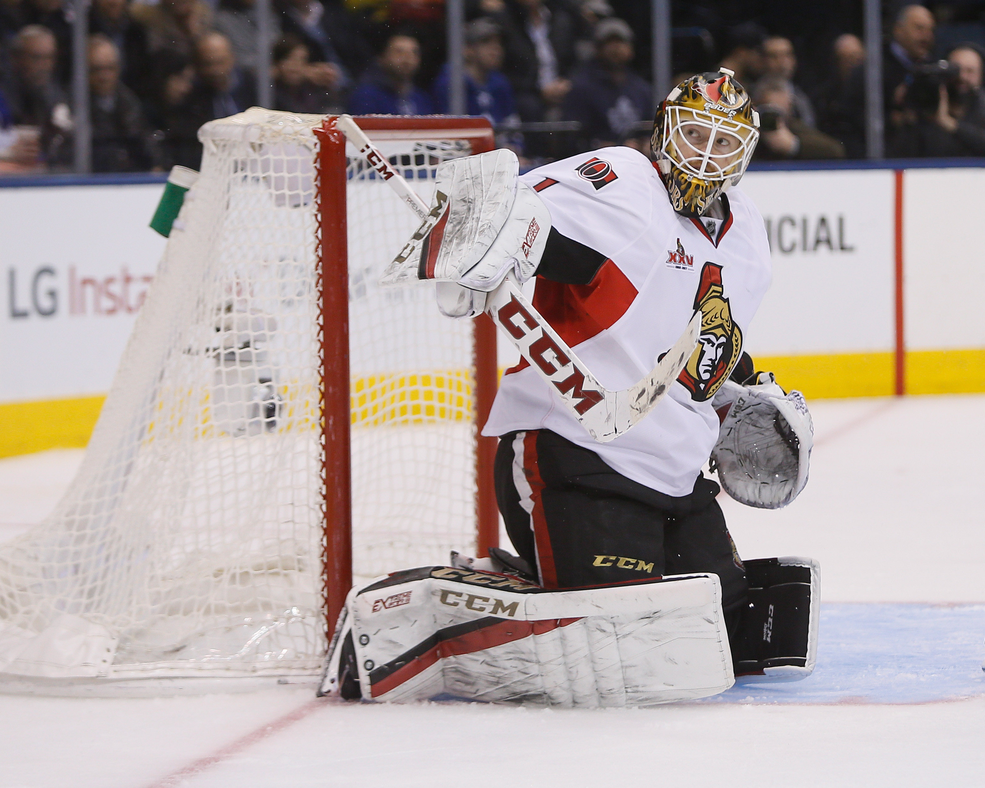 808f925ca23 NHL Power Rankings: Ottawa Senators goaltender Mike Condon (1) deflects the  puck against