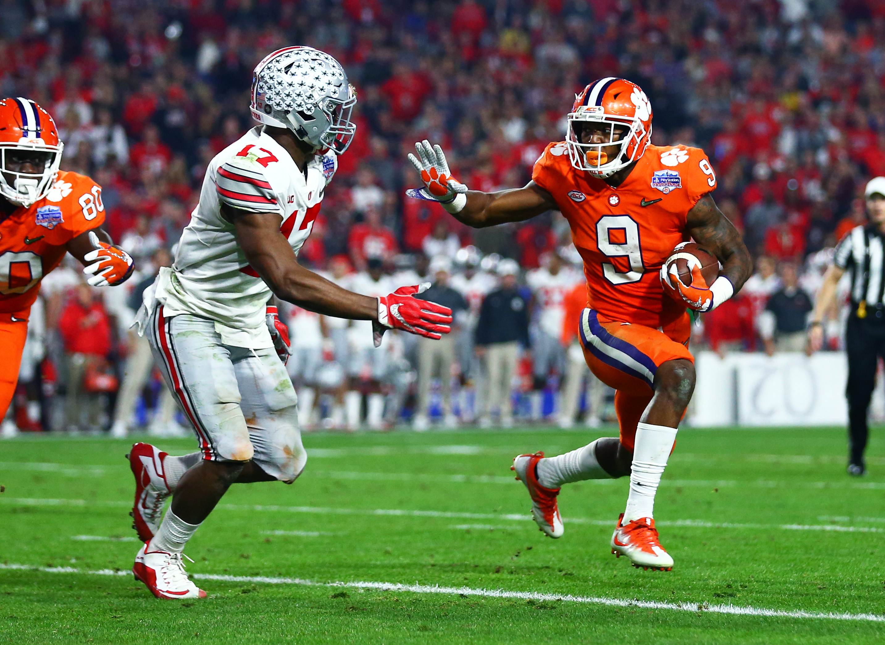 December 31, 2016; Glendale, AZ, USA; Clemson Tigers running back Wayne Gallman (9) runs the ball against Ohio State Buckeyes linebacker Jerome Baker (17) in the 2016 CFP semifinal at University of Phoenix Stadium. Mandatory Credit: Mark J. Rebilas-USA TODAY Sports