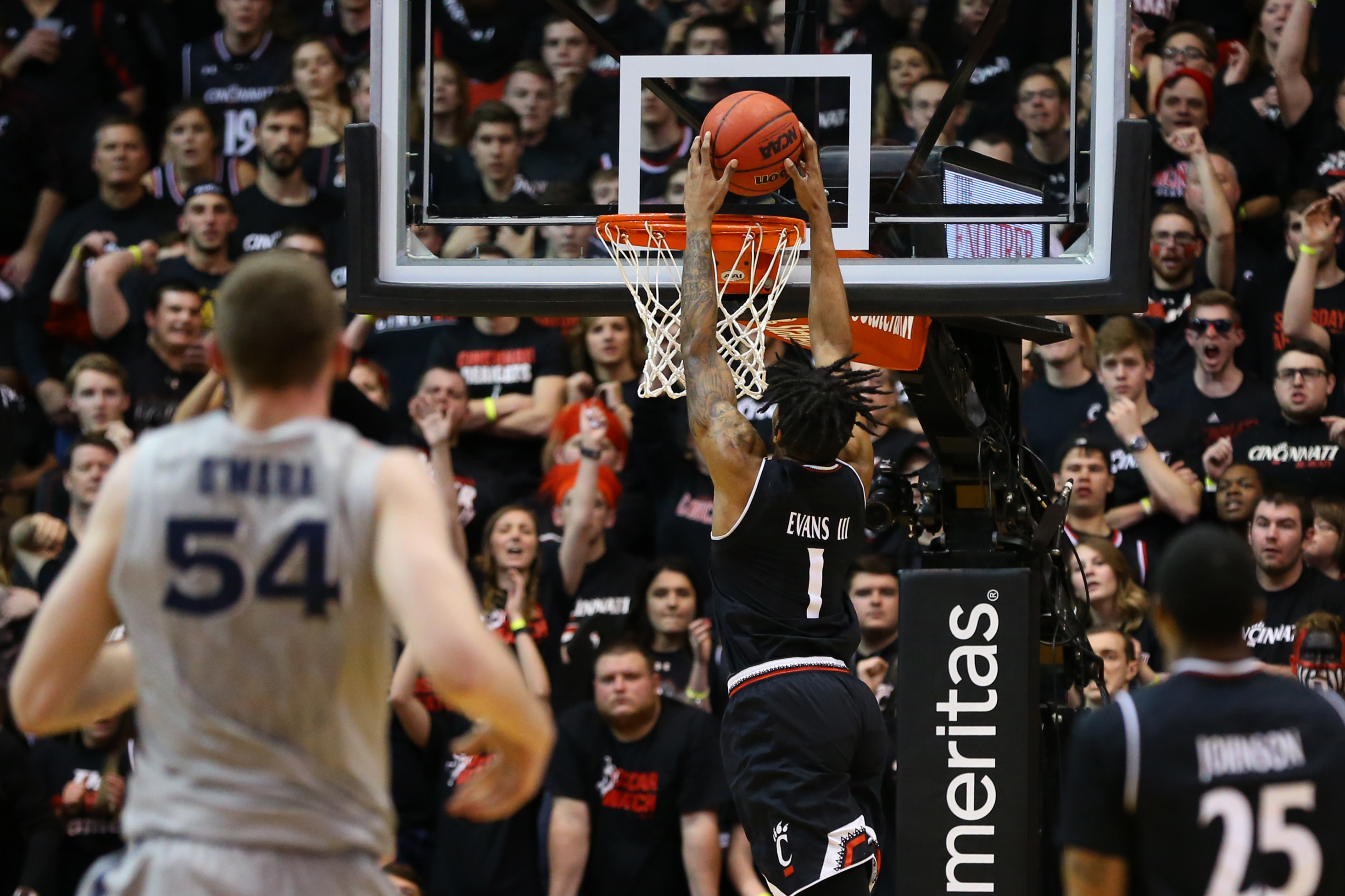 Jan 26, 2017; Cincinnati, OH, USA; Cincinnati Bearcats guard Jacob Evans (1) dunks the ball against the Xavier Musketeers in the second half at Fifth Third Arena. The Bearcats won 86-78. Mandatory Credit: Aaron Doster-USA TODAY Sports