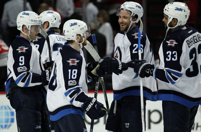 Vegas Golden Knights: Winnipeg Jets center Bryan Little (18), defenseman Dustin Byfuglien (33) and right wing Blake Wheeler (26) celebrate after defeating the Chicago Blackhawks at United Center. Mandatory Credit: Caylor Arnold-USA TODAY Sports