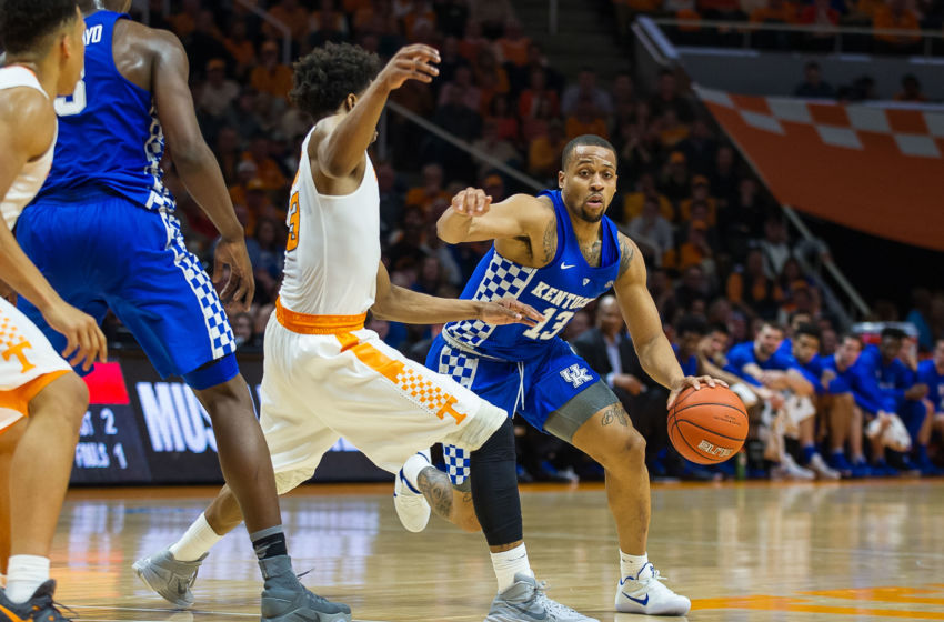 Jan 24, 2017; Knoxville, TN, USA; Kentucky Wildcats guard Isaiah Briscoe (13) drives around Tennessee Volunteers guard Robert Hubbs III (3) during the first half at Thompson-Boling Arena. Tennessee defeated Kentucky 82-80. Mandatory Credit: Bryan Lynn-USA TODAY Sports