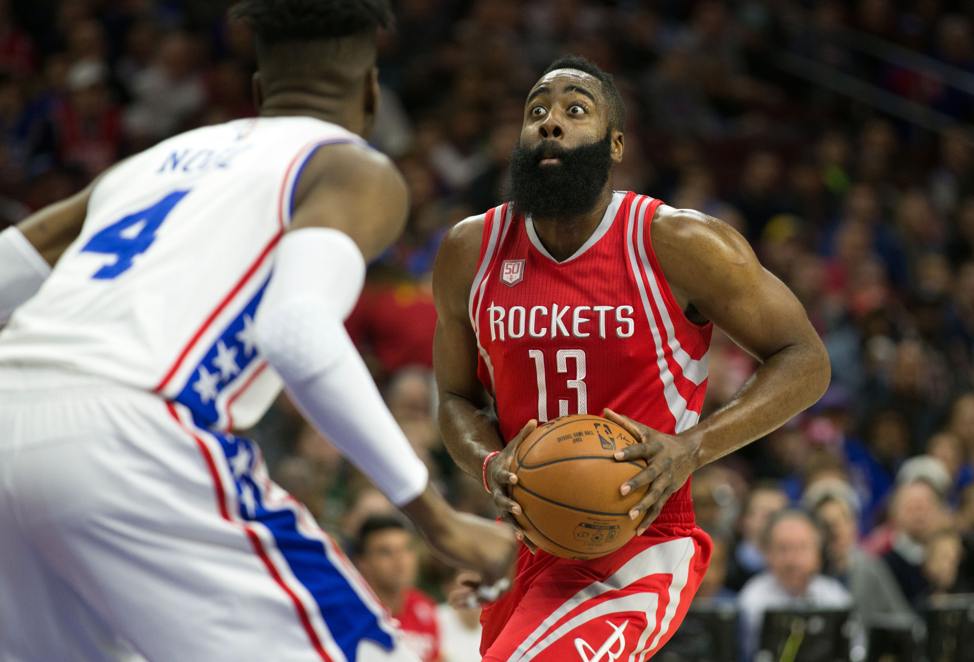 Jan 27, 2017; Philadelphia, PA, USA; Houston Rockets guard James Harden (13) attempts to drive against Philadelphia 76ers forward Nerlens Noel (4) during the first quarter at Wells Fargo Center. Mandatory Credit: Bill Streicher-USA TODAY Sports