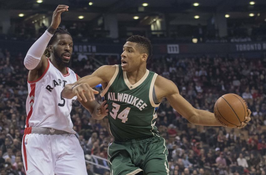 Jan 27, 2017; Toronto, Ontario, CAN; Milwaukee Bucks forward Giannis Antetokounmpo (34) controls a ball against Toronto Raptors forward DeMarre Carroll (5) during the first quarter in a game at Air Canada Centre. Mandatory Credit: Nick Turchiaro-USA TODAY Sports