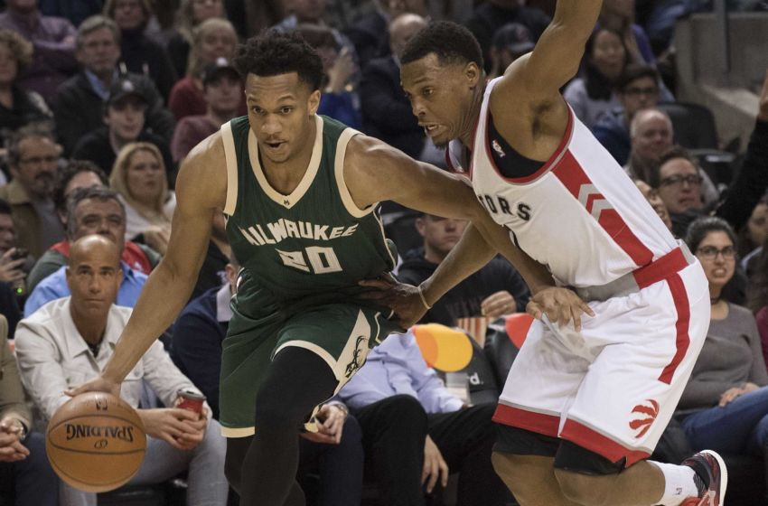 Jan 27, 2017; Toronto, Ontario, CAN; Milwaukee Bucks guard Rashad Vaughn (20) controls a ball as Toronto Raptors guard Kyle Lowry (7) tries to defend during the second quarter in a game at Air Canada Centre. Mandatory Credit: Nick Turchiaro-USA TODAY Sports
