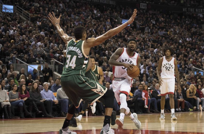 Jan 27, 2017; Toronto, Ontario, CAN; Toronto Raptors forward Terrence Ross (31) controls a ball as Milwaukee Bucks forward Giannis Antetokounmpo (34) tries to defend during the third quarter in a game at Air Canada Centre. The Toronto Raptors won 102-86. Mandatory Credit: Nick Turchiaro-USA TODAY Sports