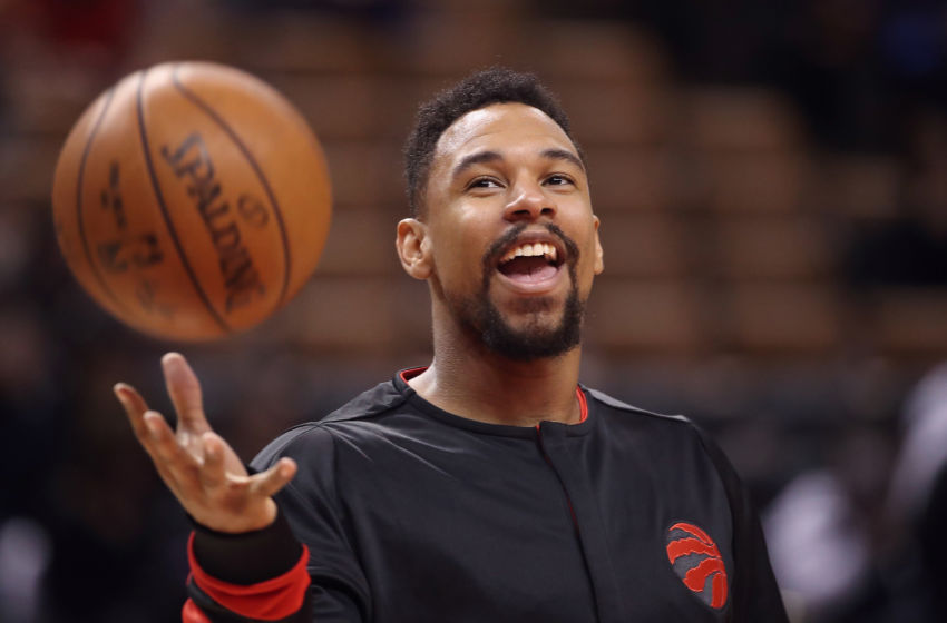 Jan 22, 2017; Toronto, Ontario, CAN; Toronto Raptors forward Jared Sullinger (0) laughs as he warms up before playing against the Phoenix Suns at Air Canada Centre. The Suns beat the Raptors 115-103. Mandatory Credit: Tom Szczerbowski-USA TODAY Sports