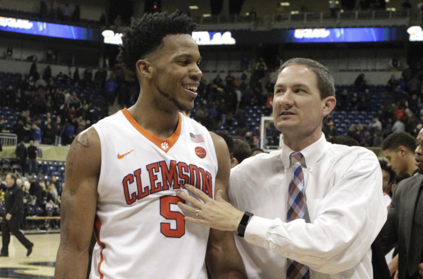 Jan 28, 2017; Pittsburgh, PA, USA; Clemson Tigers forward Jaron Blossomgame (5) and assistant coach Nick Bowman (right) celebrate after defeating the Pittsburgh Panthers at the Petersen Events Center. Clemson won 67-60. Mandatory Credit: Charles LeClaire-USA TODAY Sports