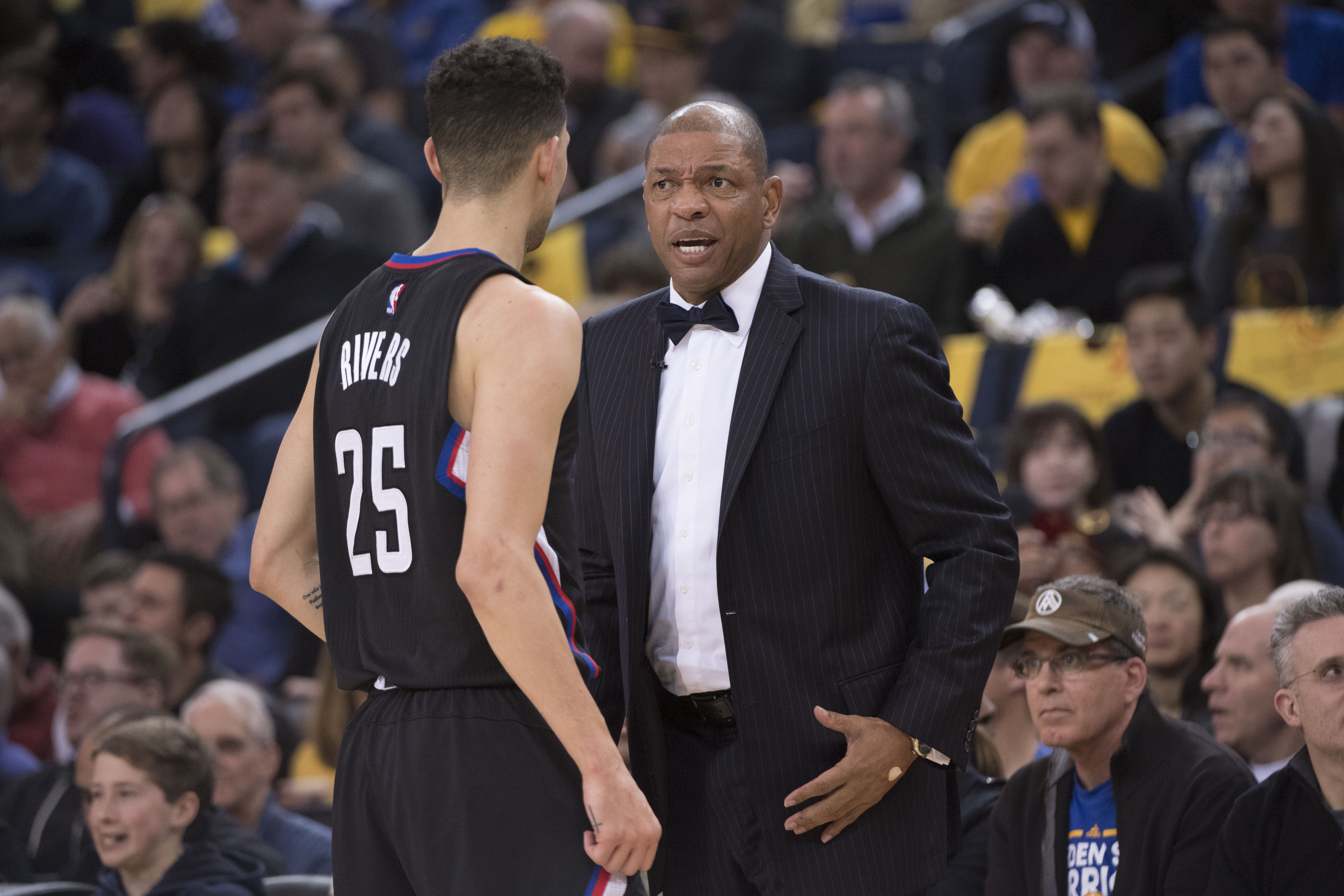 January 28, 2017; Oakland, CA, USA; Los Angeles Clippers head coach Doc Rivers (right) instructs guard Austin Rivers (25) against the Golden State Warriors during the first quarter at Oracle Arena. Mandatory Credit: Kyle Terada-USA TODAY Sports