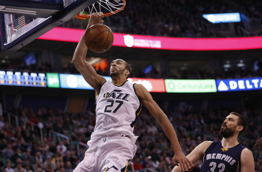 Jan 28, 2017; Salt Lake City, UT, USA; Utah Jazz center Rudy Gobert (27) dunks the ball against Memphis Grizzlies center Marc Gasol (33) in the fourth quarter at Vivint Smart Home Arena. The Memphis Grizzlies defeated the Utah Jazz 102-95. Mandatory Credit: Jeff Swinger-USA TODAY Sports