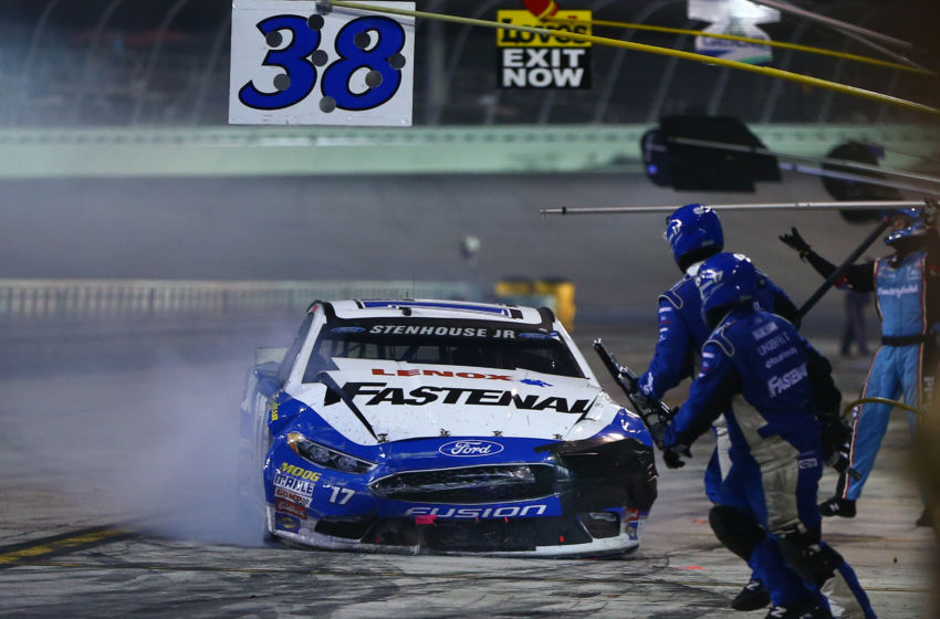 Nov 20, 2016; Homestead, FL, USA; NASCAR Sprint Cup Series driver Ricky Stenhouse Jr pits to repair damage after crashing during the Ford Ecoboost 400 at Homestead-Miami Speedway. Mandatory Credit: Mark J. Rebilas-USA TODAY Sports