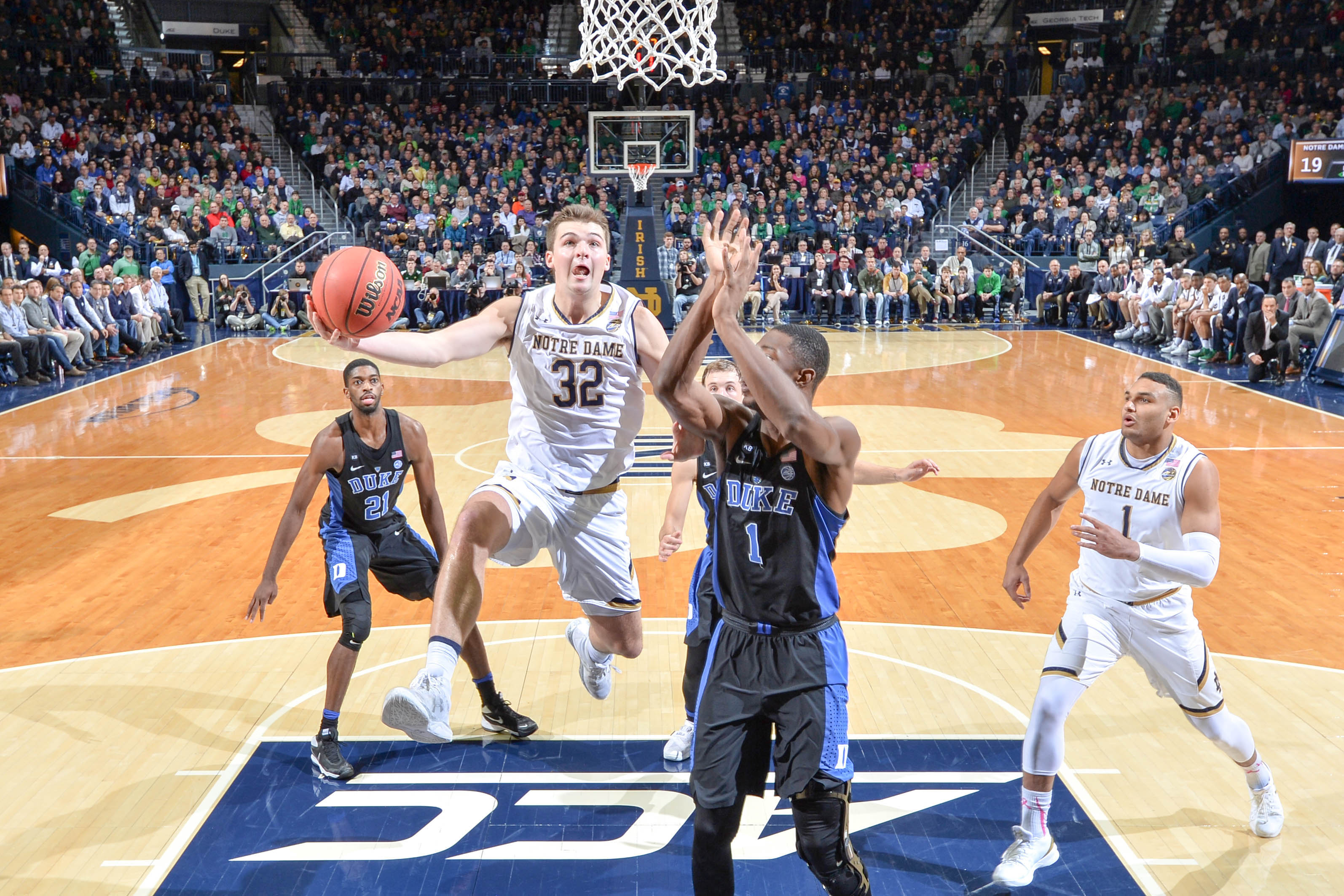Jan 30, 2017; South Bend, IN, USA; Notre Dame Fighting Irish guard Steve Vasturia (32) shoots as Duke Blue Devils forward Harry Giles (1) defends in the first half at the Purcell Pavilion. Duke won 84-74. Mandatory Credit: Matt Cashore-USA TODAY Sports