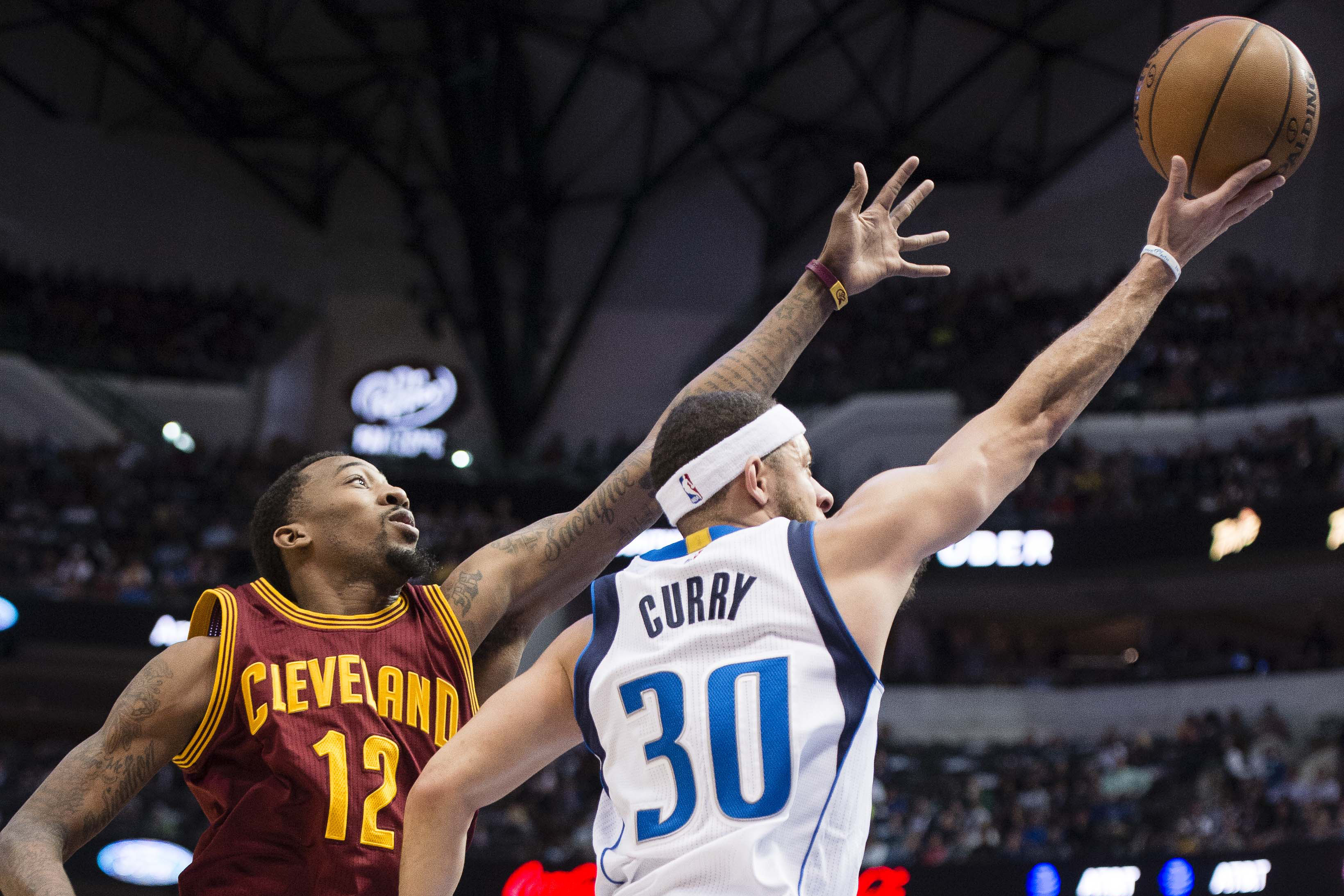 Jan 30, 2017; Dallas, TX, USA; Dallas Mavericks guard Seth Curry (30) drives to the basket past Cleveland Cavaliers guard Jordan McRae (12) during the second quarter at the American Airlines<p>Article source: <a href=