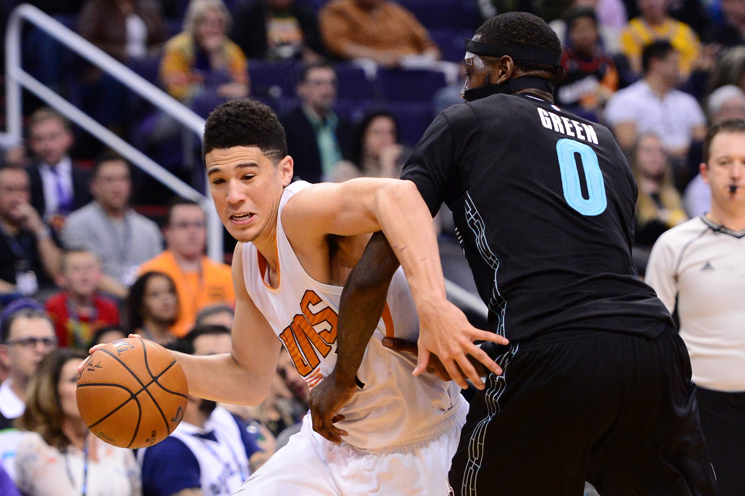 Jan 30, 2017; Phoenix, AZ, USA; Phoenix Suns guard Devin Booker (1) handles the ball against Memphis Grizzlies forward JaMychal Green (0) in the second half of the NBA game at Talking Stick Resort Arena. The Memphis Grizzlies won 115-96. Mandatory Credit: Jennifer Stewart-USA TODAY Sports