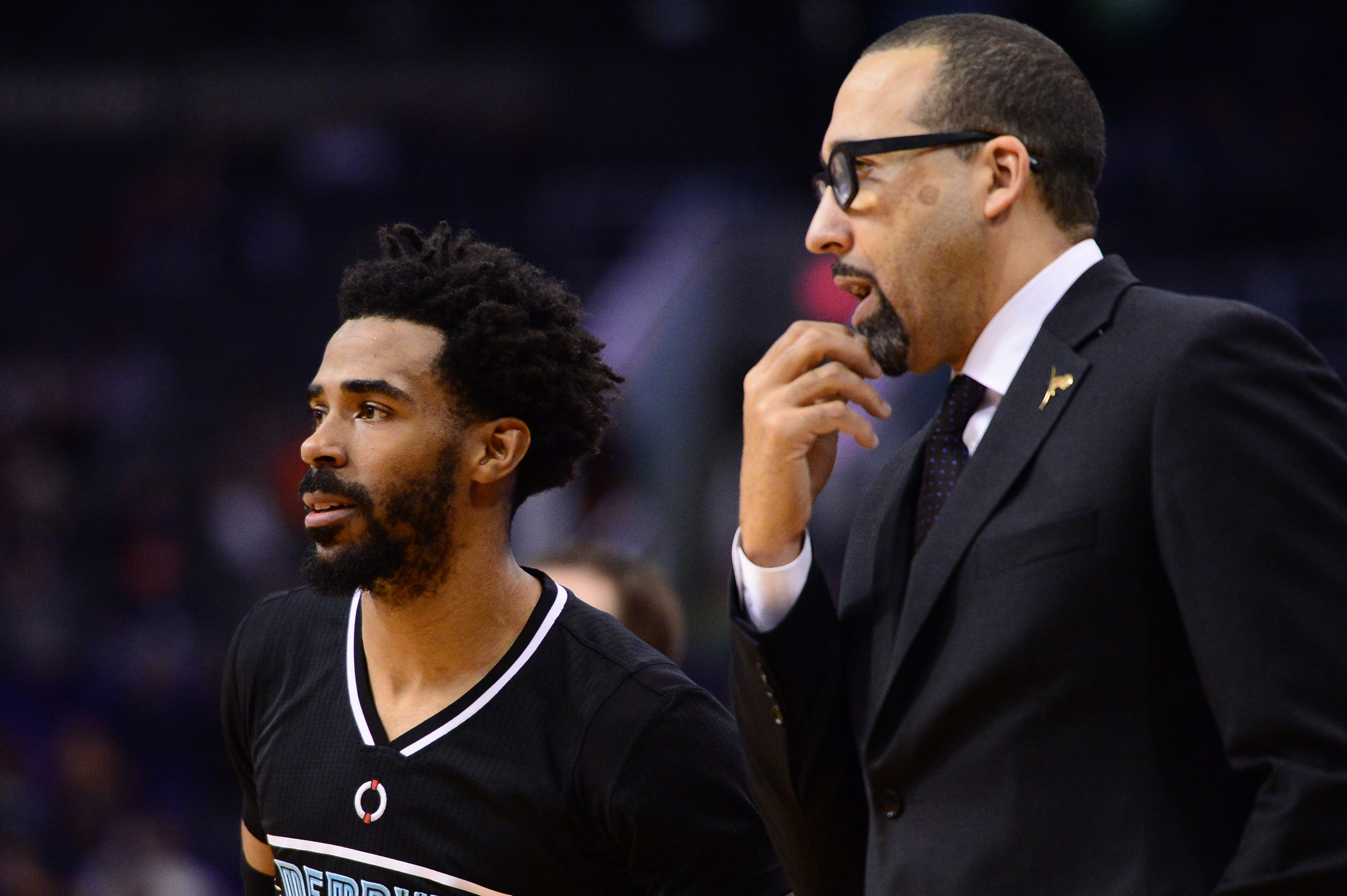 Jan 30, 2017; Phoenix, AZ, USA; Memphis Grizzlies guard Mike Conley (11) listens to Memphis Grizzlies head coach David Fizdale in the second half of the NBA game against the Phoenix Suns at Talking Stick Resort Arena. The Memphis Grizzlies won 115-96. Mandatory Credit: Jennifer Stewart-USA TODAY Sports