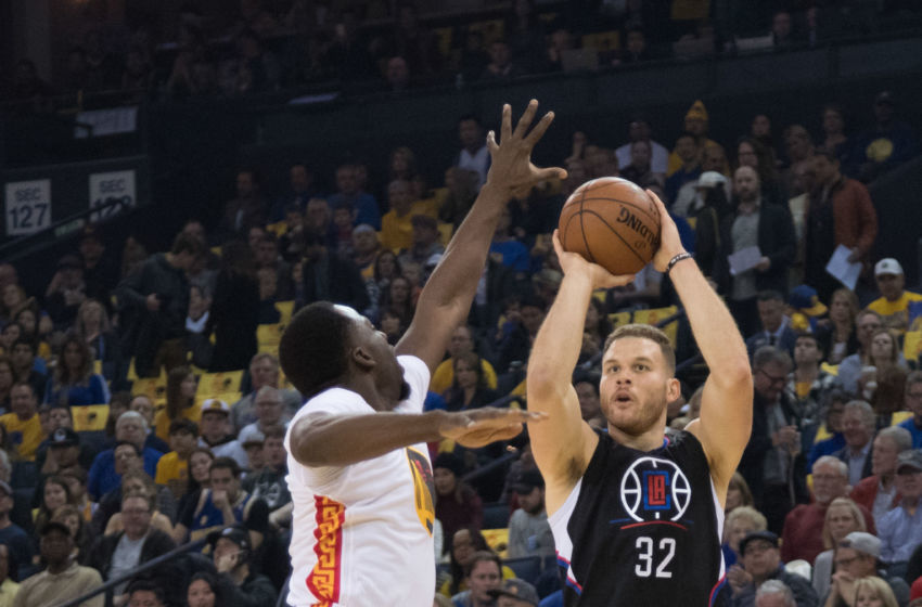 January 28, 2017; Oakland, CA, USA; Los Angeles Clippers forward Blake Griffin (32) shoots the basketball against Golden State Warriors forward Draymond Green (23) during the first quarter at Oracle Arena. Mandatory Credit: Kyle Terada-USA TODAY Sports