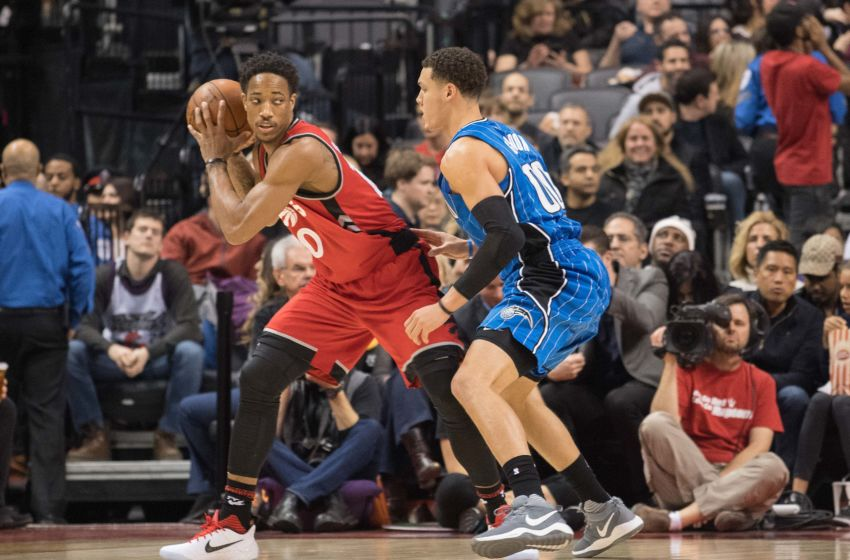 Jan 29, 2017; Toronto, Ontario, CAN; Toronto Raptors guard DeMar DeRozan (10) controls a ball as Orlando Magic forward Aaron Gordon (00) tries to defend during the second quarter in a game at Air Canada Centre. The Orlando Magic won 114-113. Mandatory Credit: Nick Turchiaro-USA TODAY Sports