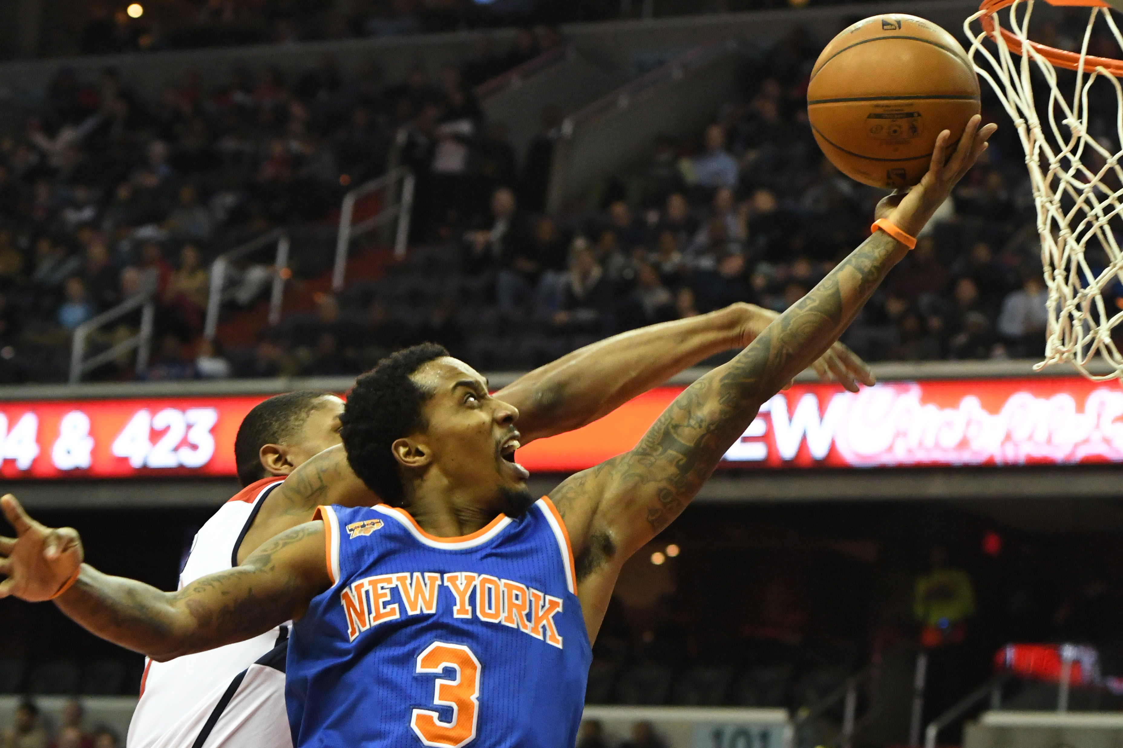Jan 31, 2017; Washington, DC, USA; New York Knicks guard Brandon Jennings (3) shoots as Washington Wizards forward Otto Porter Jr. (22) defends during the first quarter at Verizon Center. Mandatory Credit: Tommy Gilligan-USA TODAY Sports