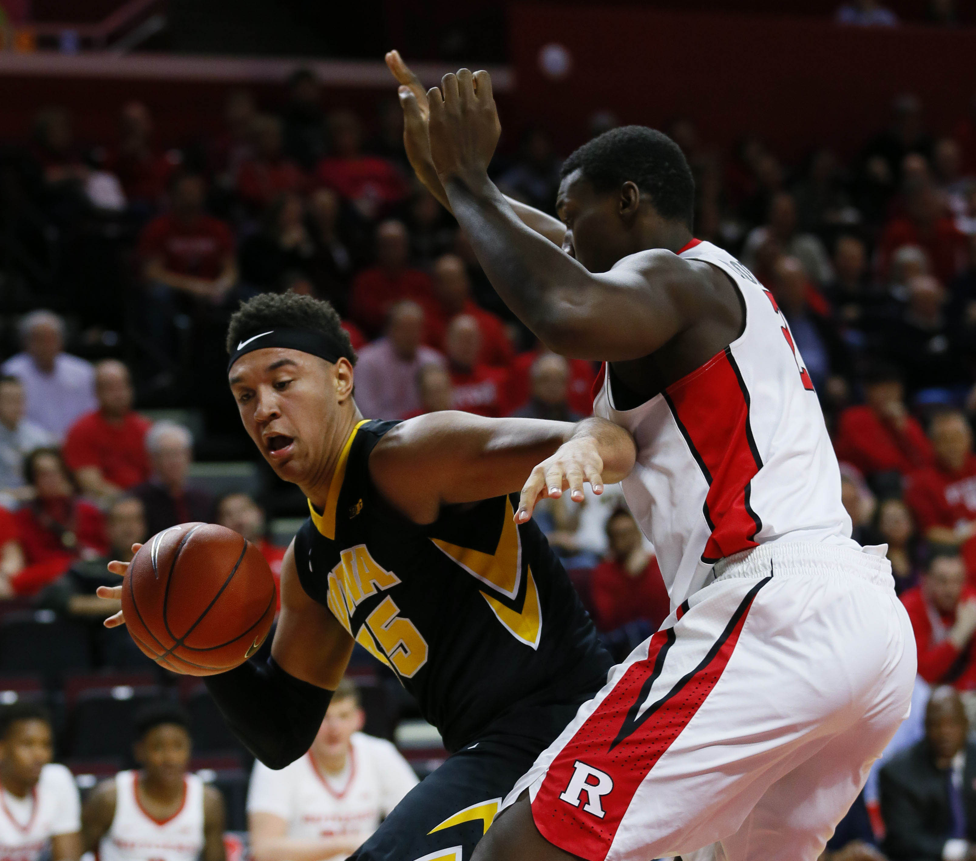 9850946-ncaa-basketball-iowa-at-rutgers