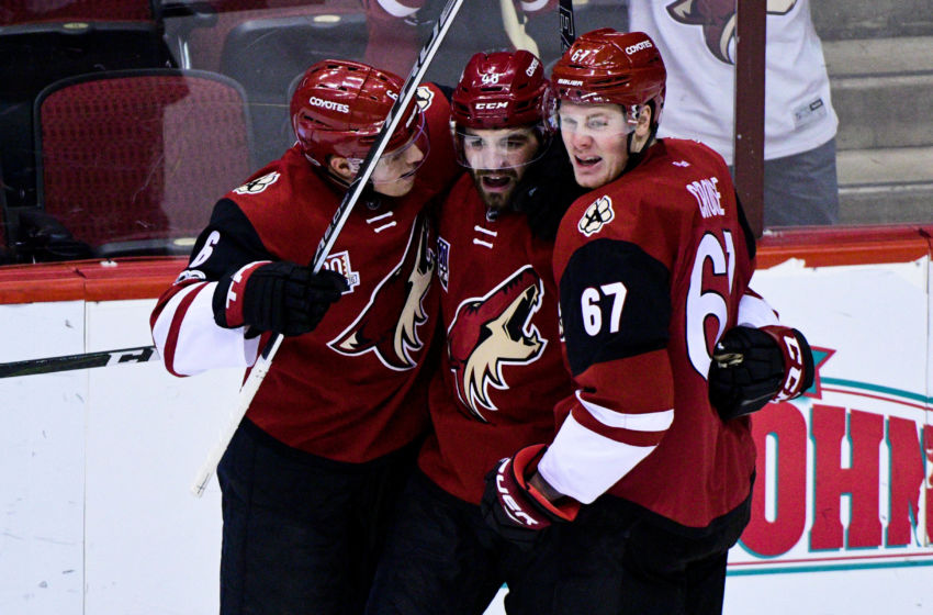 Vegas Golden Knights: Arizona Coyotes left wing Jordan Martinook (48) celebrates with defenseman Jakob Chychrun (6) and a67#@ after scoring a goal in the first period against the Los Angeles Kings at Gila River Arena. Mandatory Credit: Matt Kartozian-USA TODAY Sports