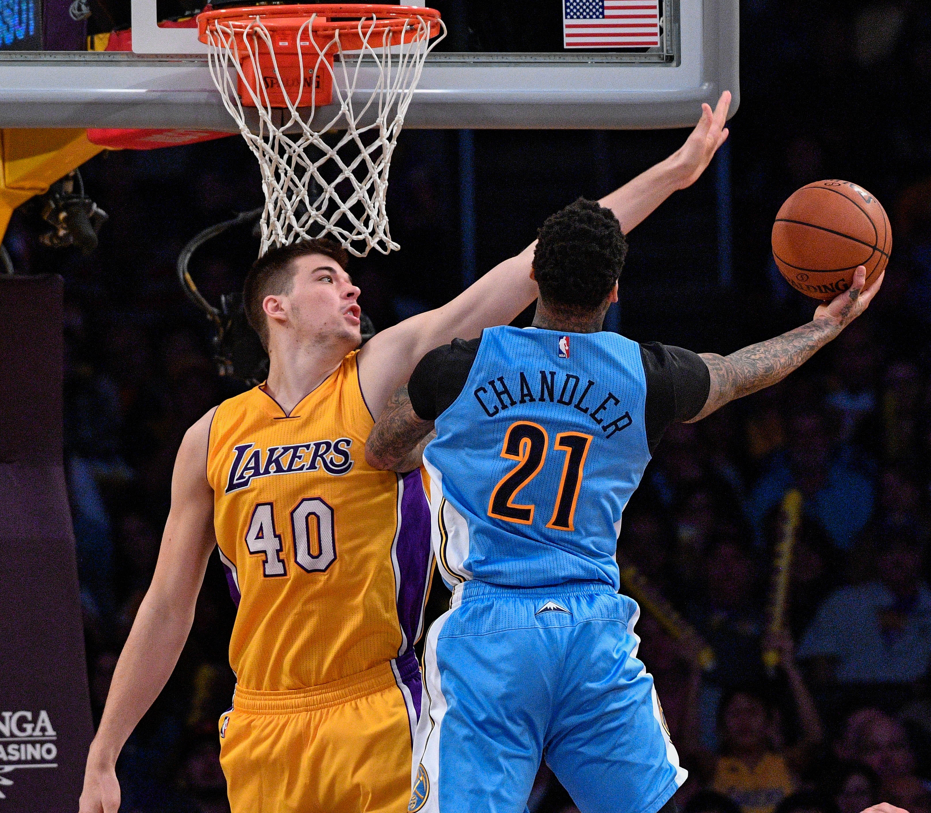 Jan 31, 2017; Los Angeles, CA, USA; Denver Nuggets forward Wilson Chandler (21) tries to score past Los Angeles Lakers center Ivica Zubac (40) during the second half at Staples Center. Mandatory Credit: Robert Hanashiro-USA TODAY Sports