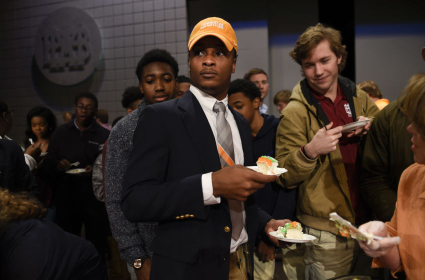 Feb 1, 2017; Nashville, TN, USA; Montgomery Bell Academy football player Ty Chandler hands out cake to his classmates after signing his letter of intent to attend the University of Tennessee at a ceremony during National Signing Day. Mandatory Credit: George Walker IV / The Tennessean via USA TODAY NETWORK