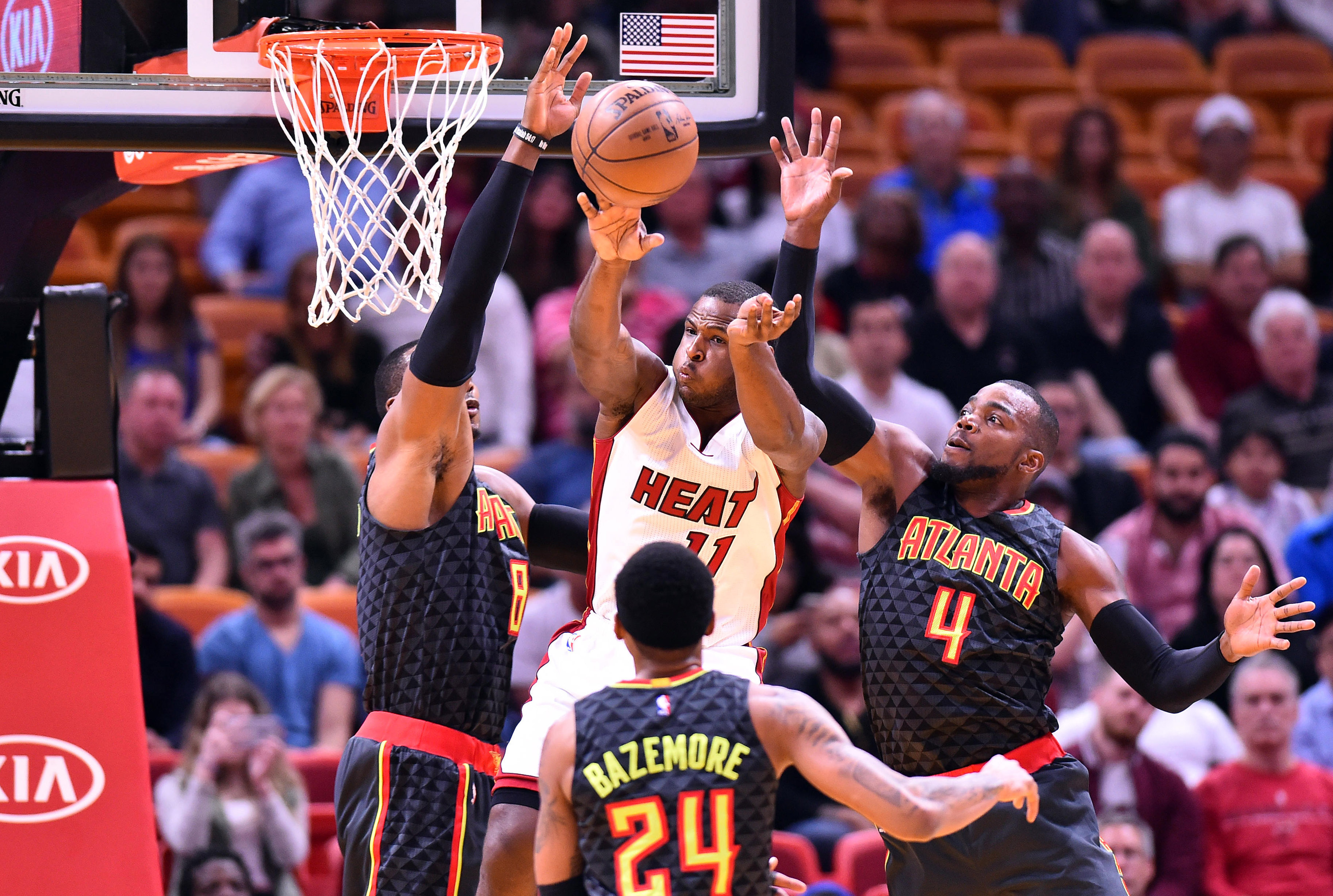 Feb 1, 2017; Miami, FL, USA; Miami Heat guard Dion Waiters (C) is pressured by Atlanta Hawks center Dwight Howard (L) and Atlanta Hawks forward Paul Millsap (R) during the first half at American Airlines Arena. Mandatory Credit: Steve Mitchell-USA TODAY Sports