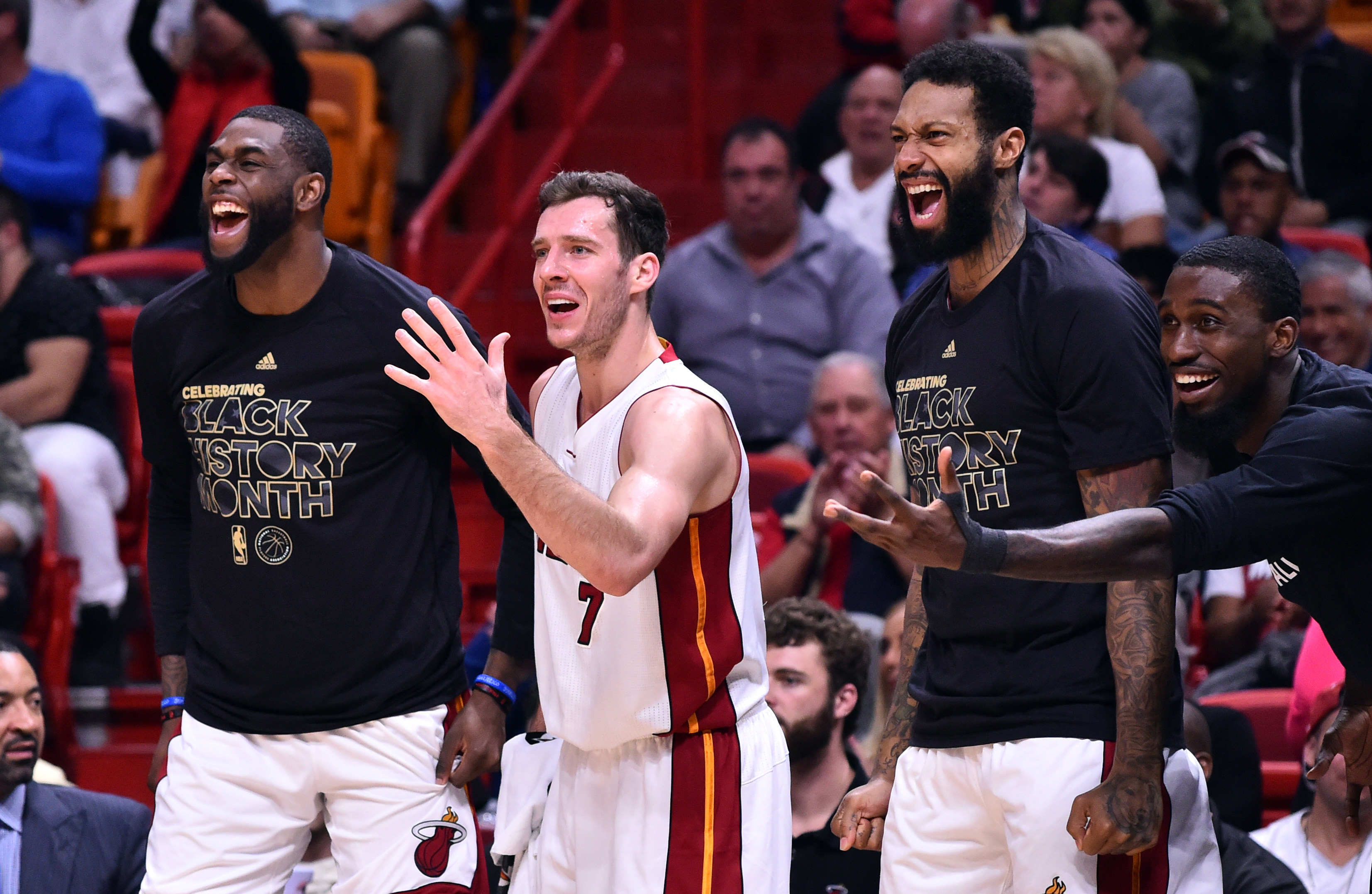 Feb 1, 2017; Miami, FL, USA; Miami Heat forward Willie Reed (L) Heat guard Goran Dragic (C) Heat forward James Johnson (third from left) and  Heat forward Okaro White (R) laugh on the bench during the second half against the Atlanta Hawks at American Airlines Arena. Miami Heat won 116-93. Mandatory Credit: Steve Mitchell-USA TODAY Sports