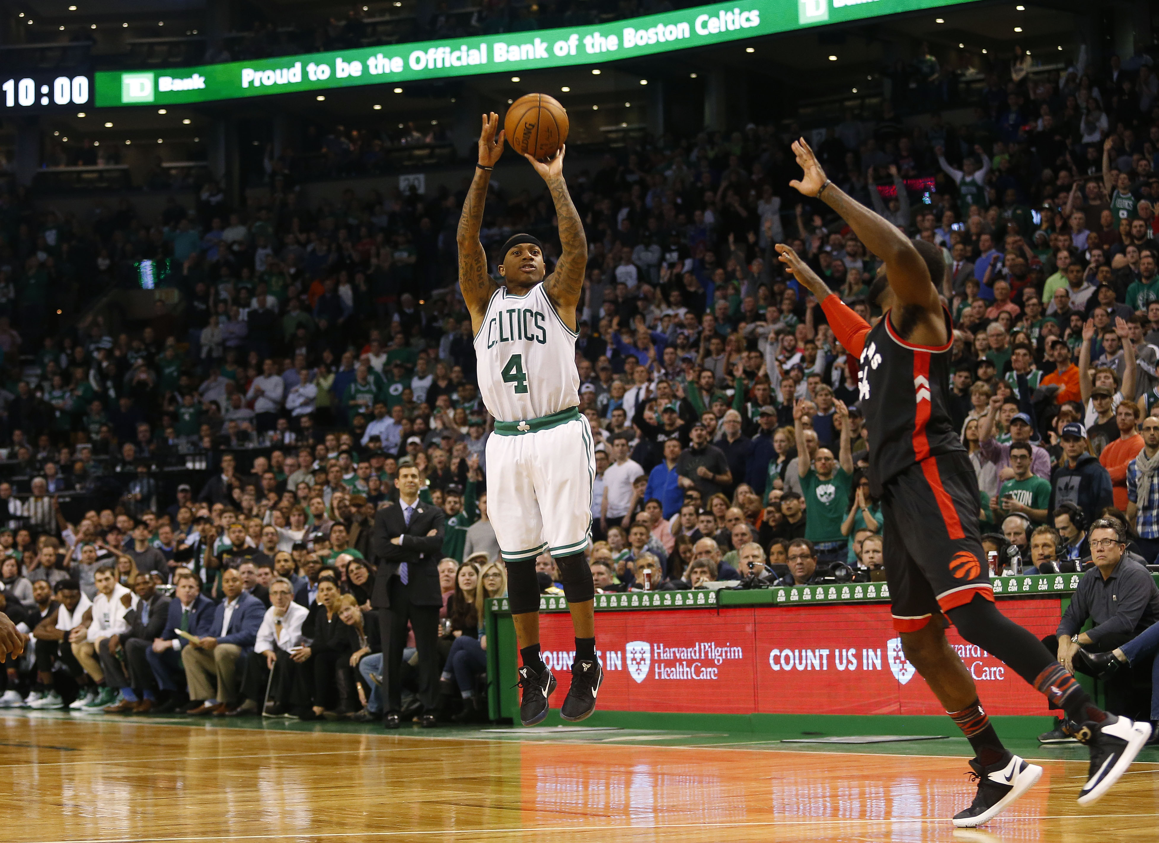 Feb 1, 2017; Boston, MA, USA; Boston Celtics guard Isaiah Thomas (4) hits a shot past Toronto Raptors forward Patrick Patterson (54) late in the fourth quarter at TD Garden. Mandatory Credit: Winslow Townson-USA TODAY Sports