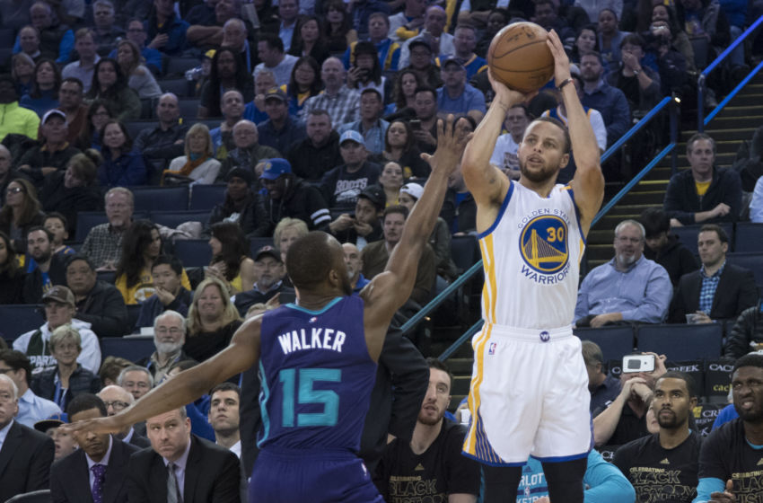 February 1, 2017; Oakland, CA, USA; Golden State Warriors guard Stephen Curry (30) shoots the basketball against Charlotte Hornets guard Kemba Walker (15) during the third quarter at Oracle Arena. The Warriors defeated the Hornets 126-111. Mandatory Credit: Kyle Terada-USA TODAY Sports