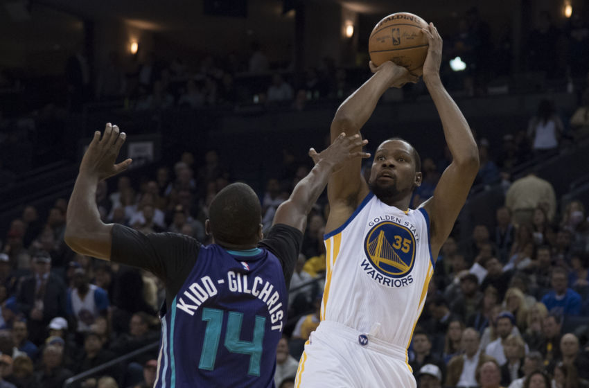 February 1, 2017; Oakland, CA, USA; Golden State Warriors forward Kevin Durant (35) shoots the basketball against Charlotte Hornets forward Michael Kidd-Gilchrist (14) during the fourth quarter at Oracle Arena. The Warriors defeated the Hornets 126-111. Mandatory Credit: Kyle Terada-USA TODAY Sports