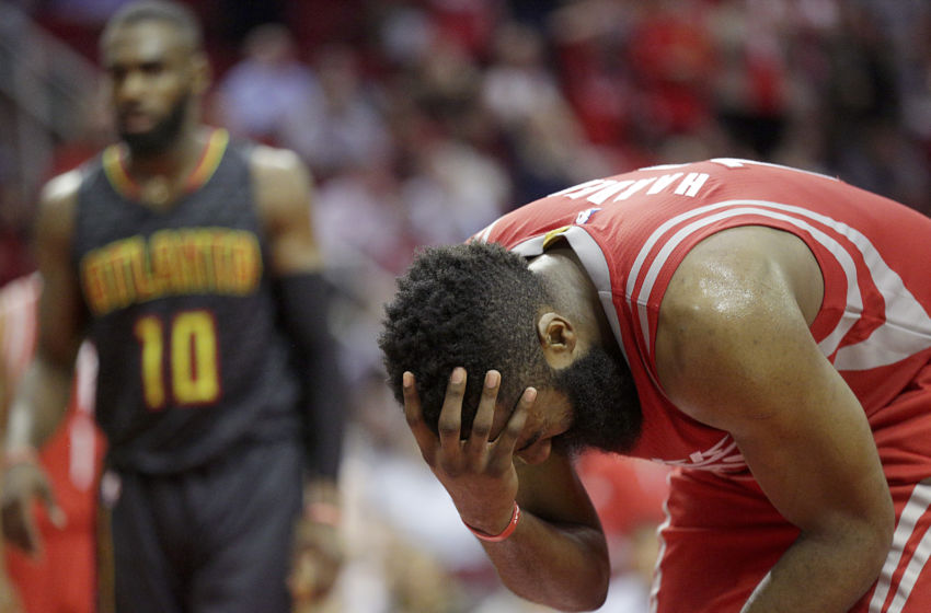 Feb 2, 2017; Houston, TX, USA;  Houston Rockets guard James Harden (13) holds his head after injuring it agains the Atlanta Hawks in the second half at Toyota Center. Atlanta Hawks won 113 to 108. Mandatory Credit: Thomas B. Shea-USA TODAY Sports