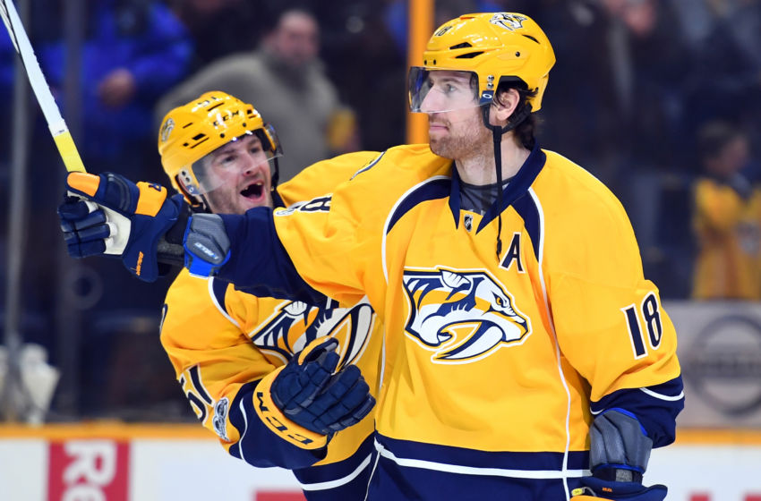 Feb 2, 2017; Nashville, TN, USA; Nashville Predators left wing Austin Watson (51) and right wing James Neal (18) celebrate after their game against the Edmonton Oilers at Bridgestone Arena. The Predators won 2-0. Mandatory Credit: Christopher Hanewinckel-USA TODAY Sports