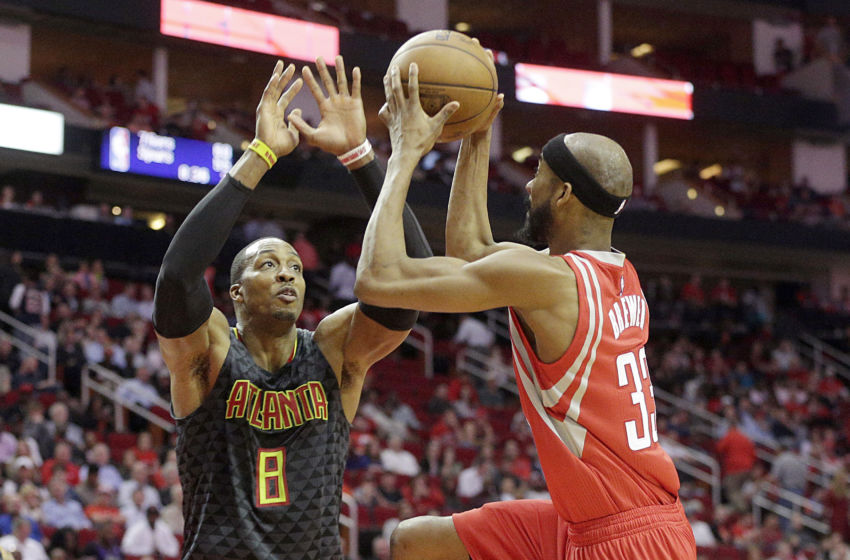 Feb 2, 2017; Houston, TX, USA; Houston Rockets forward Corey Brewer (33) drives against Atlanta Hawks center Dwight Howard (8) in the second half at Toyota Center. Atlanta Hawks won 113 to 108. Mandatory Credit: Thomas B. Shea-USA TODAY Sports
